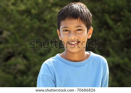 Happy smile from young boy in countryside sunshine - stock photo