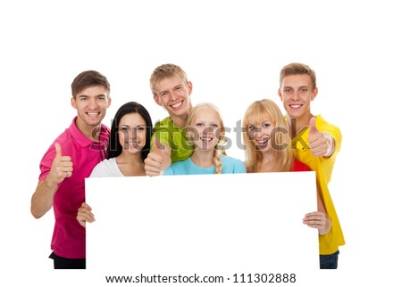 Happy smile group of young people holding a blank white card board, signboard, show thumb up gesture empty bill board Isolated over white background - stock photo