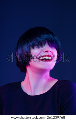 happy smile. model in studio on a dark background. - stock photo