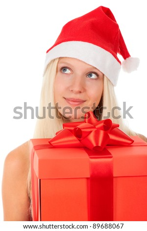 happy smile santa girl hold gift box, woman wear red christmas hat looking up to empty copy space, isolated over white background - stock photo