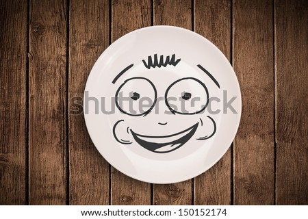 Happy smiley cartoon face on colorful dish plate and grungy background ...