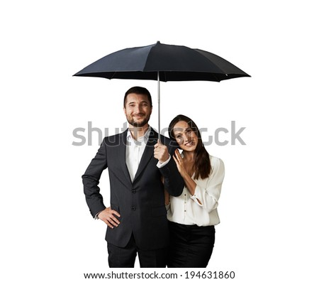happy smiley couple under black umbrella. isolated on white background - stock photo