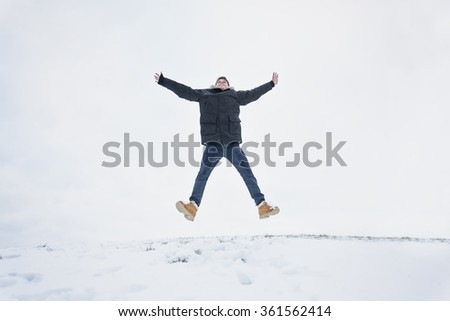 happy smiling active man jumping - stock photo