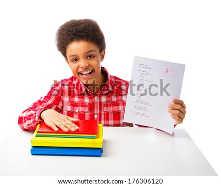 Happy smiling African American school boy, teenager with test and A grade, school and education concept. Isolated, over white background with copy space - stock photo