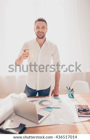 Happy smiling architect having break and drinking coffee