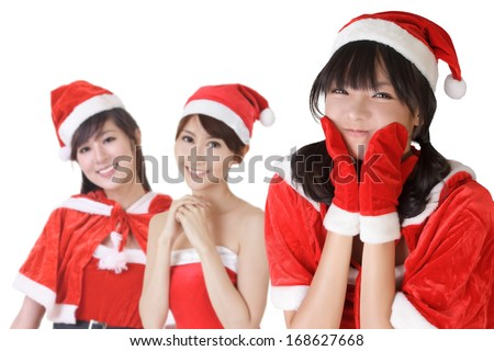 Happy smiling Asian Christmas girls, closeup portrait of three young women. - stock photo