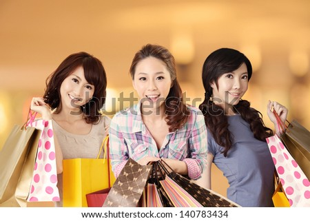 Happy smiling Asian shopping women in the modern mall. - stock photo