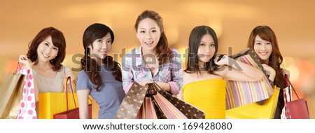 Happy smiling Asian shopping women on white background.