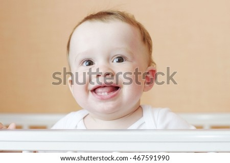 happy smiling baby in white bed