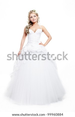 Happy smiling beautiful bride blond girl in white wedding dress with hairstyle and bright makeup on white background full length - stock photo