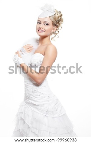 Happy smiling beautiful bride blond girl in white wedding dress with hairstyle and bright makeup on white background - stock photo