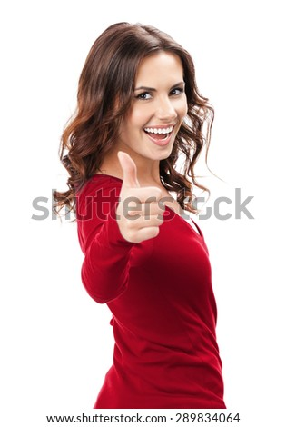 Happy smiling beautiful young brunette woman showing thumbs up gesture, isolated on white background