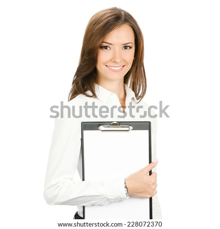 Happy smiling beautiful young business woman showing blank clipboard, isolated over white background - stock photo