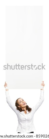 Happy smiling beautiful young business woman showing blank signboard, isolated over white background. To provide maximum quality, I have made this image by combination of two photos.