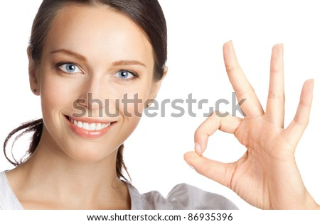 Happy smiling beautiful young business woman showing okay gesture, isolated over white background - stock photo