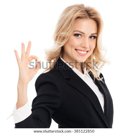 Happy smiling beautiful young businesswoman showing okay gesture, isolated against white background - stock photo