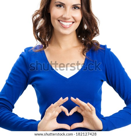 Happy smiling beautiful young woman showing heart symbol gesture, isolated over white background