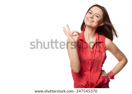 Happy smiling beautiful young woman showing okay gesture, isolated over white background - stock photo