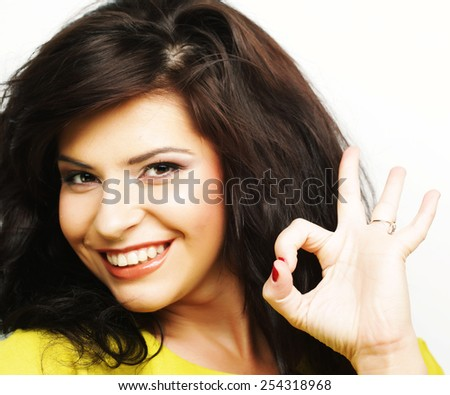 Happy smiling beautiful young woman showing thumbs up gesture