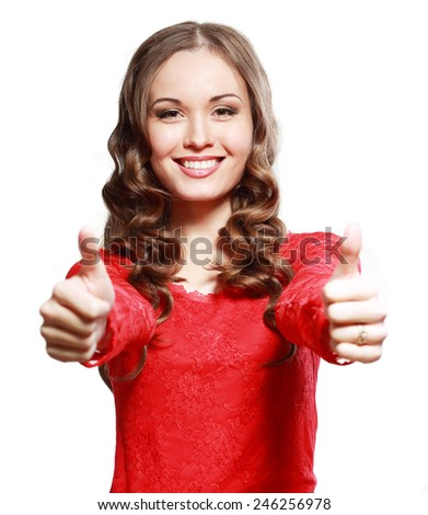 Happy smiling beautiful young woman showing thumbs up gesture, isolated over white background - stock photo