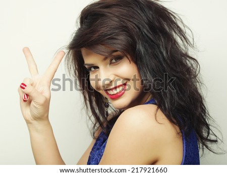 Happy smiling beautiful young woman showing two fingers or victory gesture  - stock photo