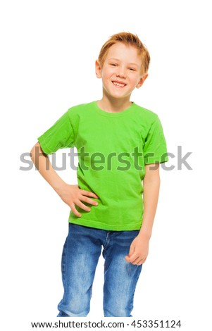 Happy smiling boy in green t-shirt and denim