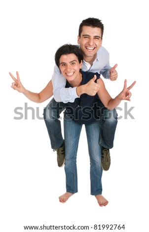 happy smiling brother and sister showing victory hand and thumbs up sign while playing together piggyback (full length picture, isolated on white background)