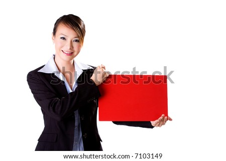 happy smiling business executive holding a F4 size red board