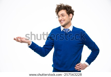 Happy smiling business man in glasses presenting something on the hand - stock photo