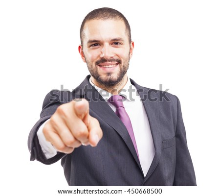 Happy smiling business man pointing the finger at you, isolated on white background