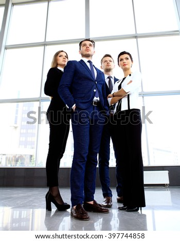Happy smiling business team in office - stock photo