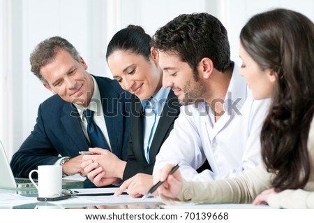 Happy smiling business team working together in a modern office - stock photo