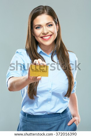 Happy smiling business woman showing credit card. Portrait of smiling business woman. - stock photo