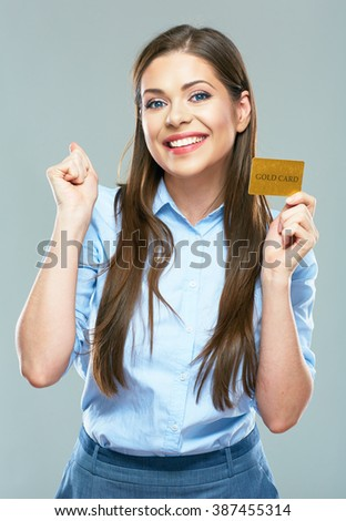 Happy smiling business woman showing credit card. Portrait of smiling business woman.