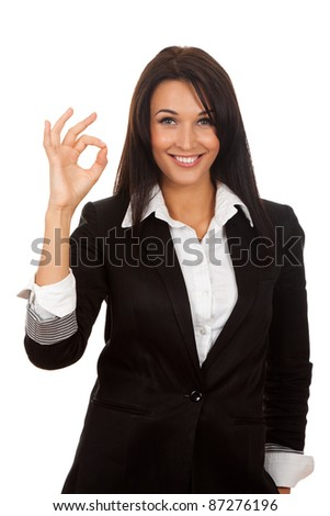 Happy smiling business woman with ok hand sign, isolated on white background