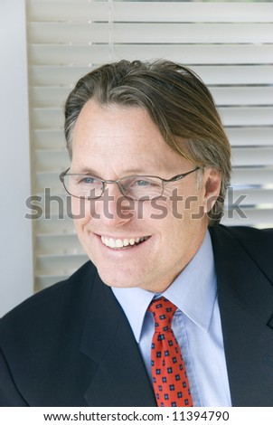 Happy smiling businessman in spectacles.
