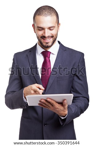 Happy smiling businessman with digital tablet on white background - stock photo