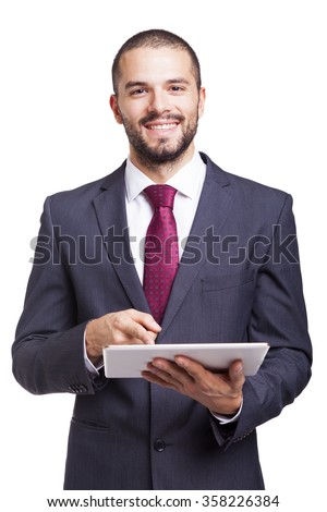 Happy smiling businessman with digital tablet on white background