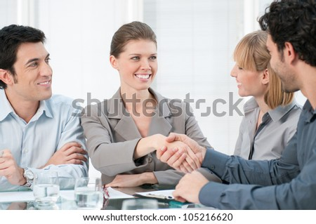 Happy smiling businesswoman shaking hands after a business meeting - stock photo