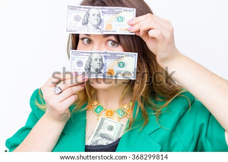 Happy smiling businesswoman  wearing in green jacket with money. Woman holding money. Concept of money