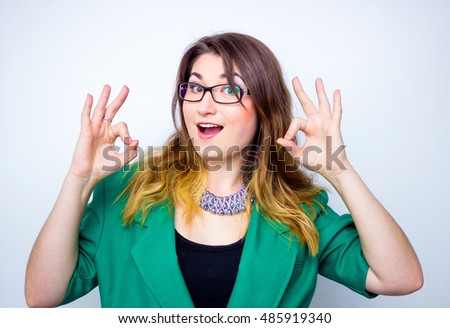 Happy smiling businesswoman wearing in green jacket with thumbs up gesture