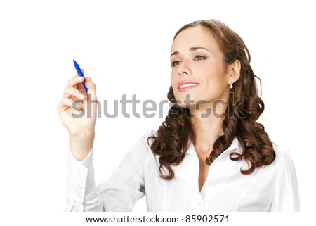 Happy smiling cheerful beautiful young business woman writing or drawing on screen with blue marker, isolated over white background