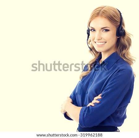 Happy smiling cheerful beautiful young female support phone operator or phone worker in headset and blue clothing. Customer service assistance concept. - stock photo