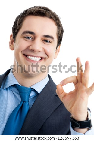 Happy smiling cheerful business man with okay gesture, isolated over white background