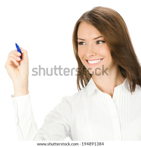 Happy smiling cheerful young business woman writing or drawing on screen with blue marker, isolated on white background - stock photo