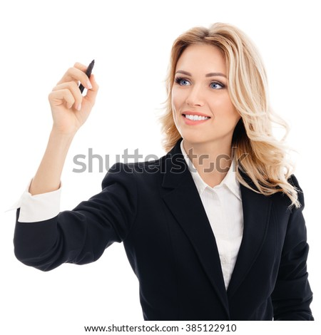 Happy smiling cheerful young businesswoman writing or drawing something on screen or transparent glass, by blue marker, isolated over white background - stock photo