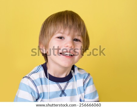 Happy smiling child looking at camera - stock photo