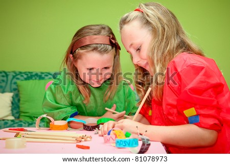 happy smiling children playing drawing and making craft in class at kindergarden school - stock photo
