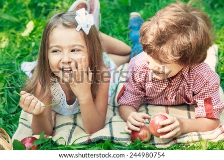 Happy smiling children playing outdoors in spring park. Picnic concept - stock photo