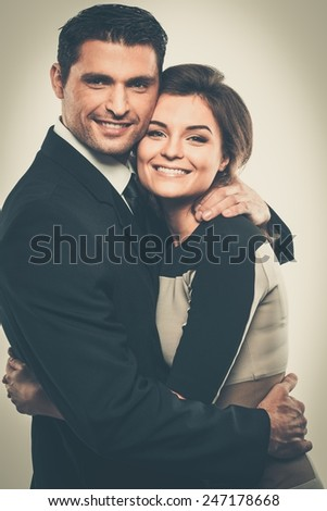 Happy smiling couple in suit and dress  - stock photo